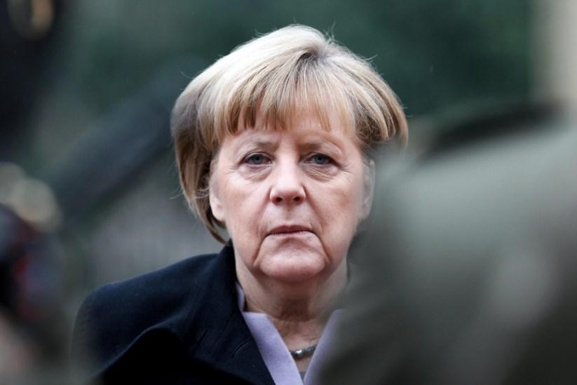 Angela Merkel foi lacónica na resposta às críticas e ameaças de Donald Trump