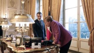 Emanuel Macron e Angela Merkel desempenham papel decisivo na reforma da zona euro