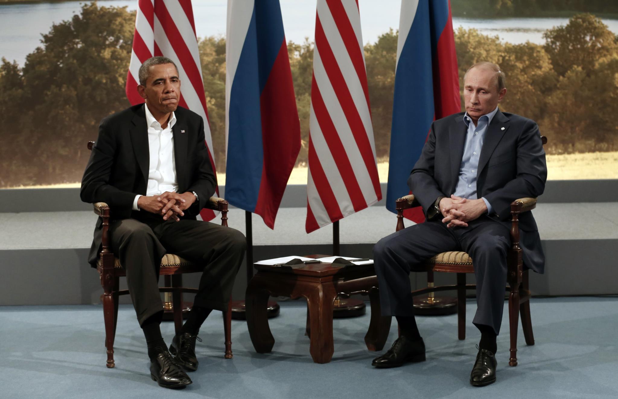 Barack Obama num encontro com o Presidente russo Vladimir Putin durante a cimeira do G8, em Junho de 2013