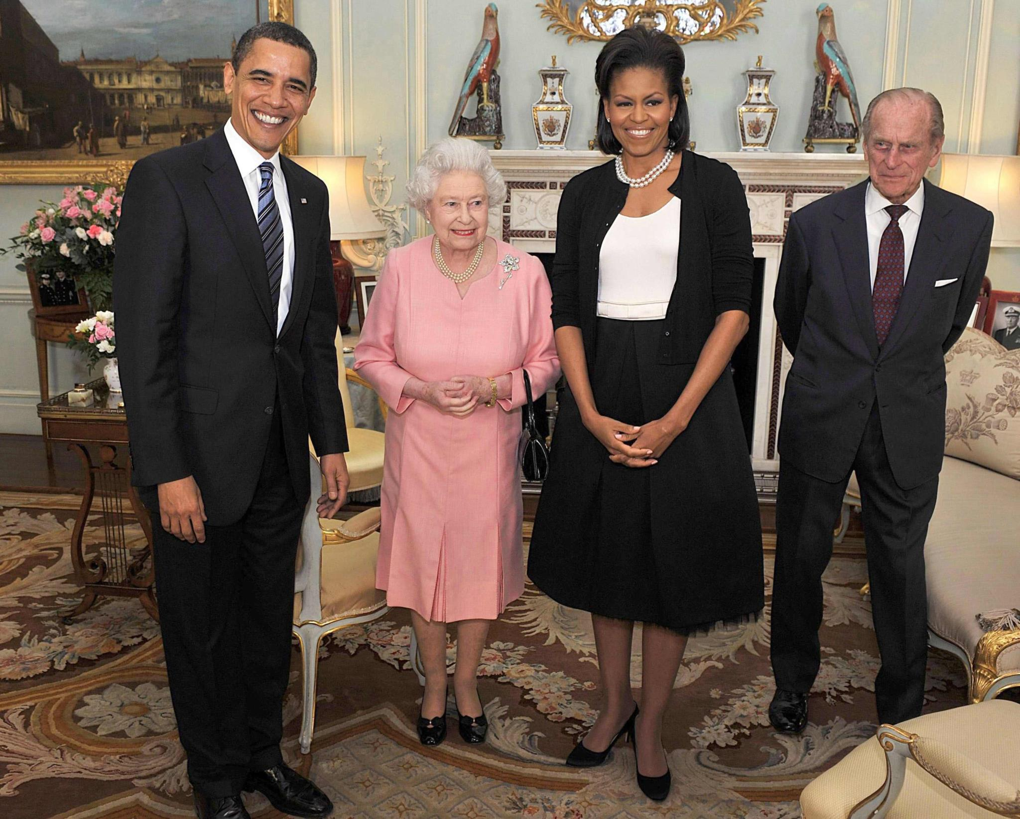 Em 2009, com o então Presidente dos EUA e a primeira-dama, Barack e Michelle Obama, no Palácio de Buckingham