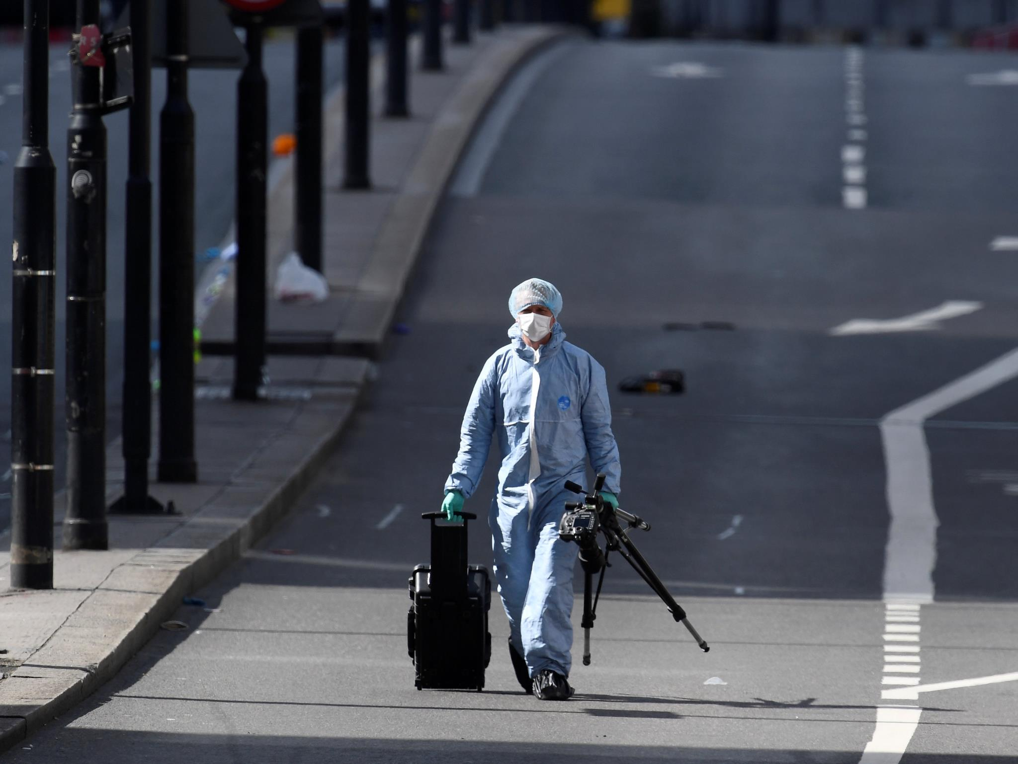 A police forensics investigator works on London Bridge after an attack left 7 people dead and dozens injured in London