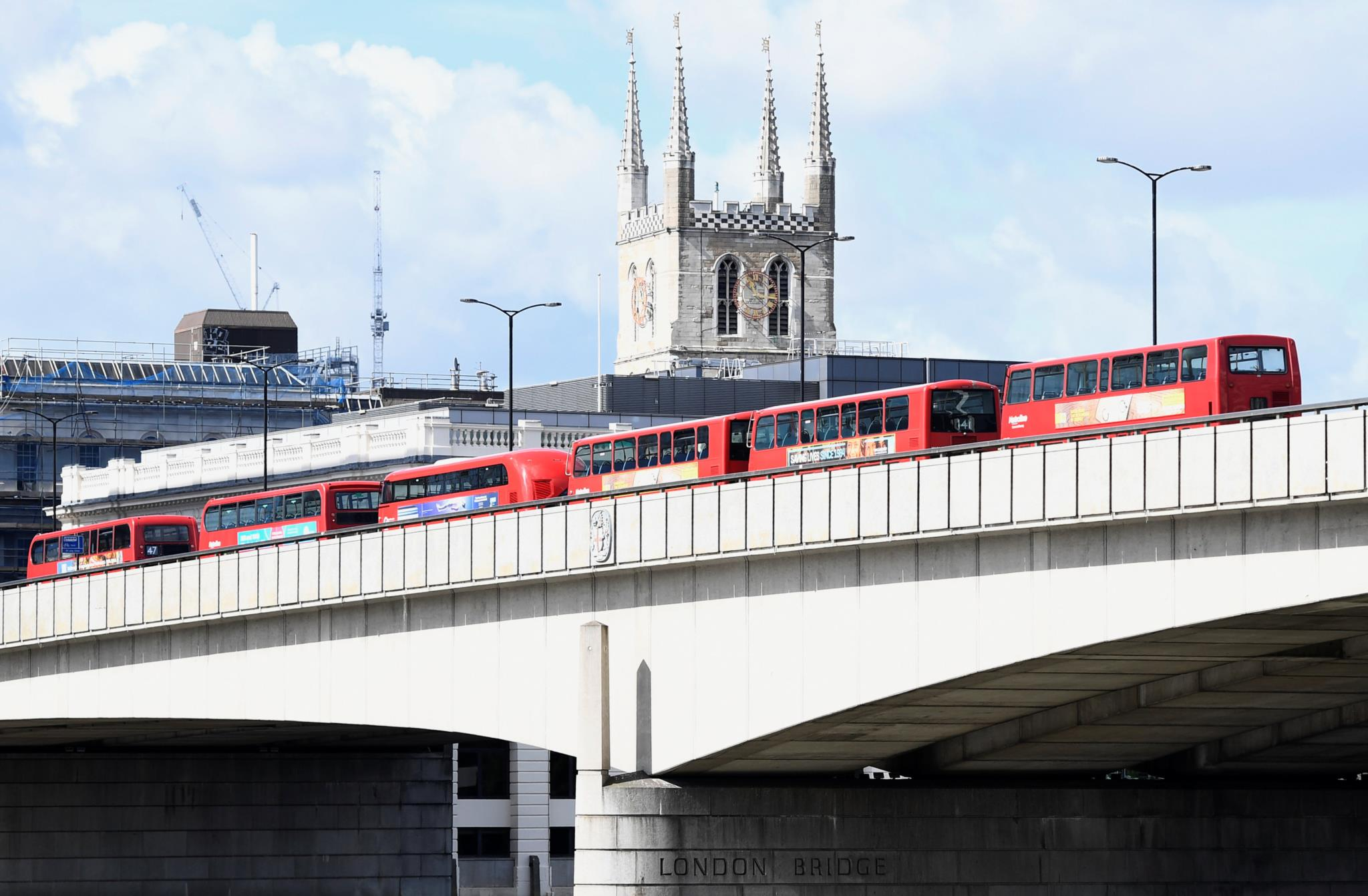 Abandoned buses are lined up on London Bridge after an attack left 7 people dead and dozens injured in London
