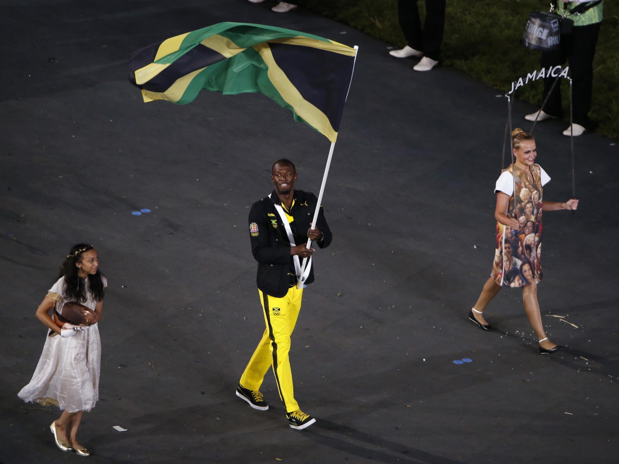 Usain Bolt com a bandeira da Jamaica na cerimónia de abertura dos Jogos Olímpicos de Londres em 2012.